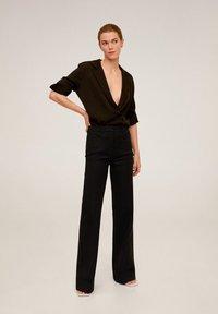 Mango - MIRANDA - Spodnie materiałowe - schwarz - 1