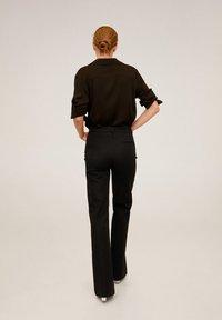 Mango - MIRANDA - Spodnie materiałowe - schwarz - 2