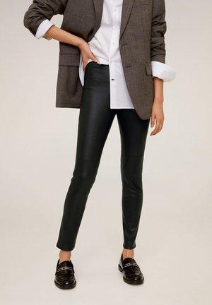STRETCH - Leather trousers - schwarz
