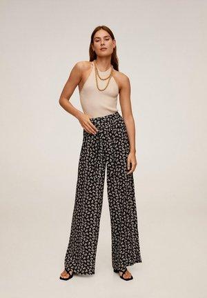 DELHI - Spodnie materiałowe - schwarz