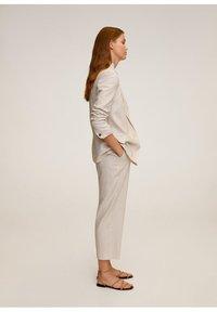 Mango - WAVE - Spodnie materiałowe - beige - 3