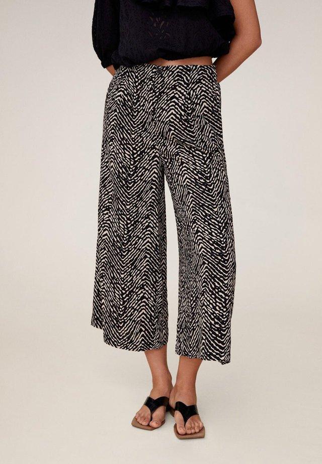 CRETA - Trousers - schwarz
