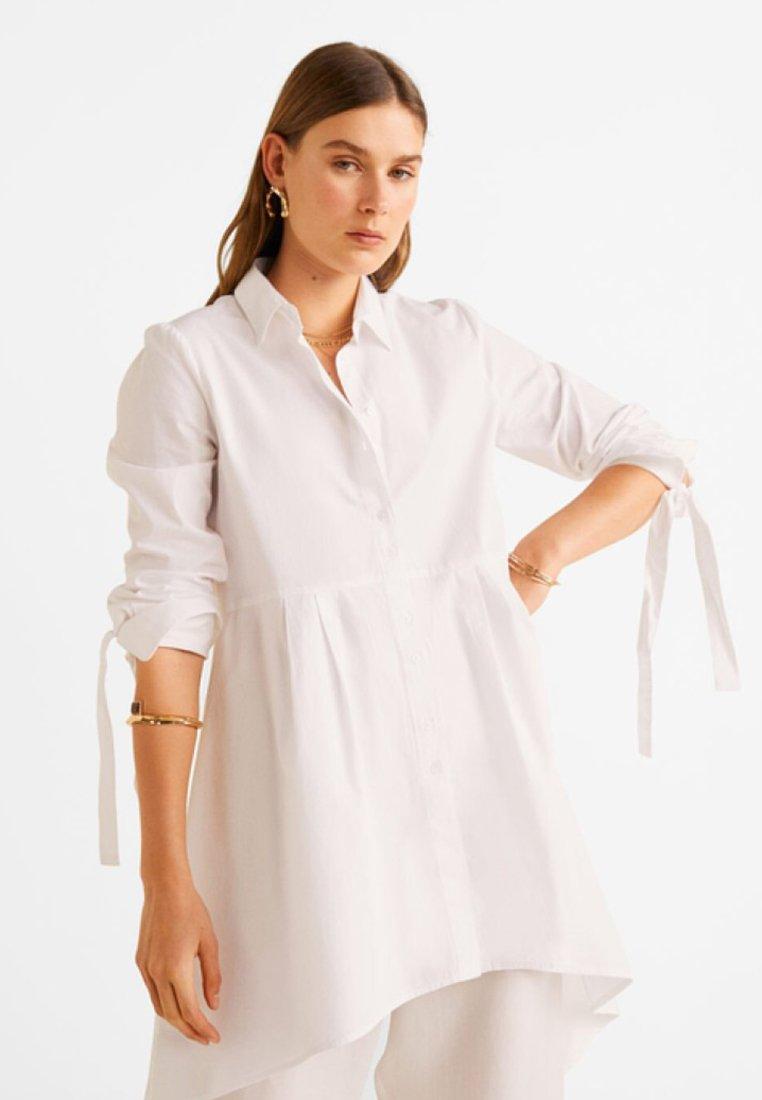 mit-schleife-am-Ärmel---button-down-blouse by mango