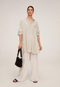 Mango - ANNETA - Button-down blouse - beige - 1