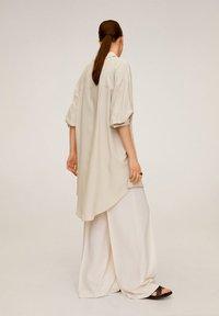 Mango - ANNETA - Button-down blouse - beige - 2