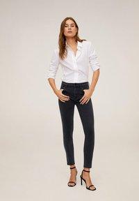 Mango - STUDS - Jeans Skinny Fit - black denim - 0