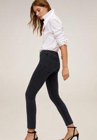 Mango - STUDS - Jeans Skinny Fit - black denim - 1