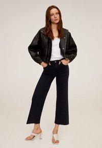 Mango - AUDREY - Flared Jeans - black denim - 1