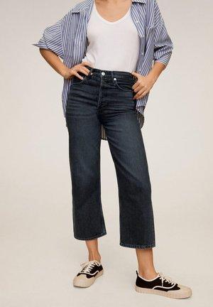 GABRIELA - Flared Jeans - black denim