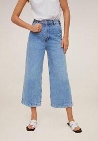 Mango - CARLOTA - Flared Jeans - blue - 1