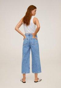 Mango - CARLOTA - Flared Jeans - blue - 0