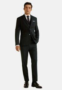 Mango - BRASILIA - Suit trousers - black - 1
