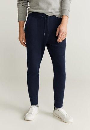 COHEN - Tracksuit bottoms - navy blue