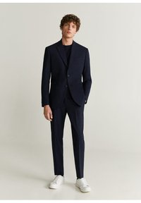 Mango - TRAVEL - Suit trousers - dunkles marineblau