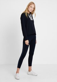 Marc O'Polo - CONTRAST PIPING - Leggings - midnight blue - 1