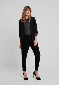 Marc O'Polo - Pantalon de survêtement - black - 2