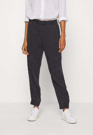 TRAVEL PANTS - Trousers - black