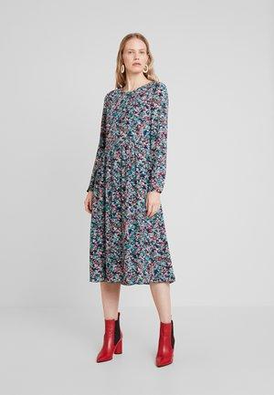 Korte jurk - combo