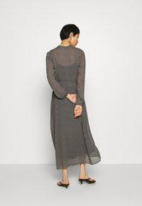 Marc O'Polo - DRESS LONG STYLE BELTED WAIST DETAILED NECKLINE - Vestido informal - black - 2