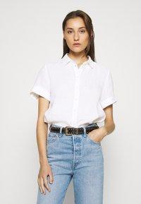 Marc O'Polo - BLOUSE SHORT SLEEVE BUTTON THROUG STYLE - Button-down blouse - white - 0
