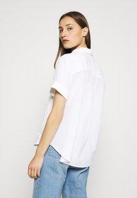 Marc O'Polo - BLOUSE SHORT SLEEVE BUTTON THROUG STYLE - Button-down blouse - white - 2