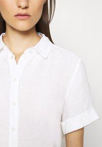 Marc O'Polo - BLOUSE SHORT SLEEVE BUTTON THROUG STYLE - Button-down blouse - white - 4