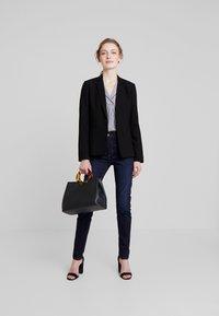 Marc O'Polo - TROUSER HIGH WAIST - Slim fit jeans - dark blue denim - 1