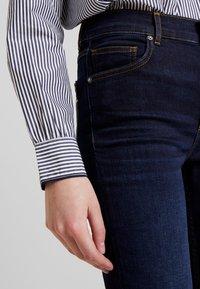 Marc O'Polo - TROUSER HIGH WAIST - Slim fit jeans - dark blue denim - 5