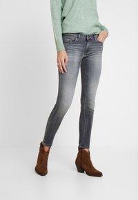 Marc O'Polo - TROUSER LOW WAIST - Slim fit jeans - dusty grey smoke wash - 0