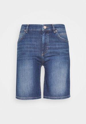 Denim shorts - mid commercial wash