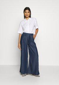 Mavi - FLARE LEG PANTS - Trousers - denim - 1