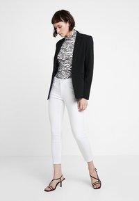 Mavi - ADRIANA ANKLE - Jeans Skinny Fit - white washed denim - 1