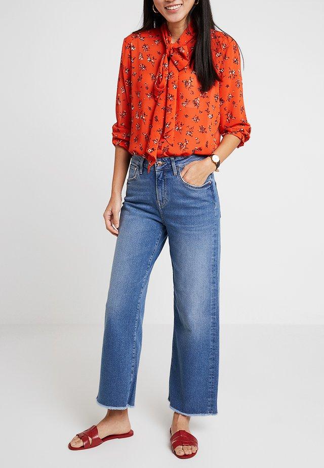 LIA - Flared Jeans - dark brushed