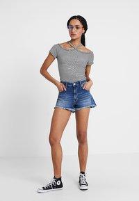 Mavi - ROSIE - Shorts di jeans - dark brushed 80's - 1