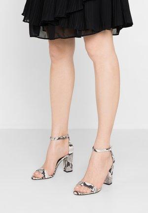BEELLA - High heeled sandals - black/white