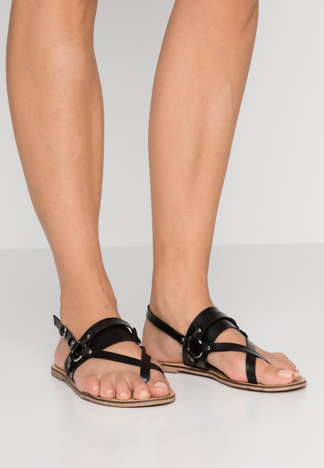 SKYLA - T-bar sandals - black