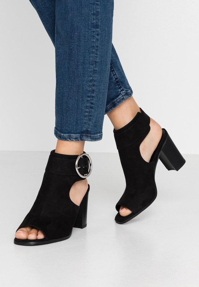 DARLYNN - Ankle cuff sandals - black