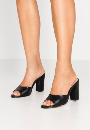 BREEZE - Heeled mules - black paris