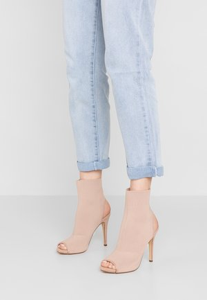 RAANDY - High heeled ankle boots - blush