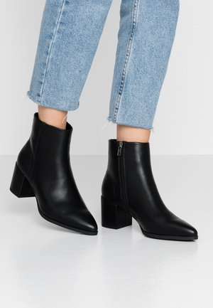 DAFNII - Kotníkové boty - black