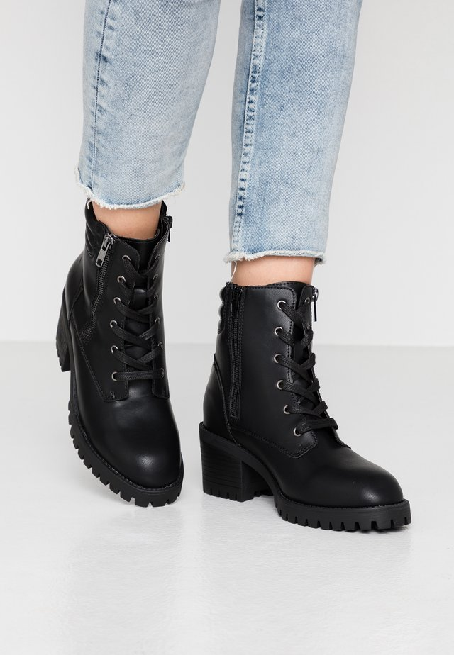 HUSH - Lace-up ankle boots - black paris