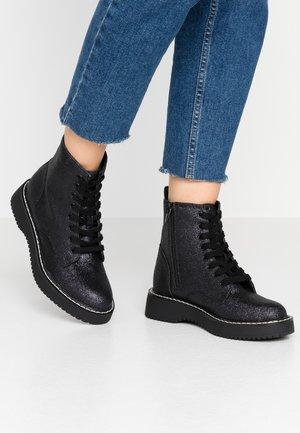 KURRT - Platform ankle boots - glitter