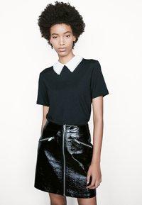 maje - TIVOLA - T-shirt med print - noir - 0