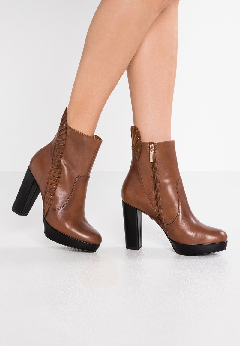 Marcel Ostertag x Tamaris - High heeled ankle boots - cognac