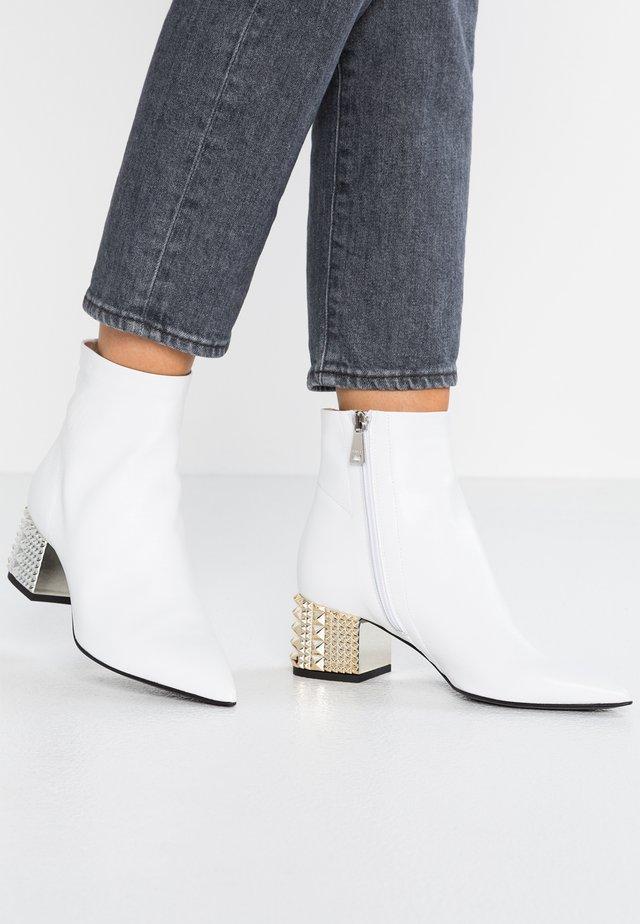 Støvletter - bianco
