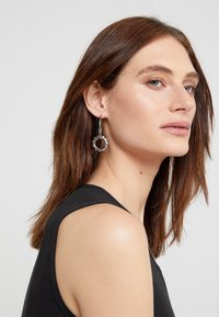 Maria Black - SENORITA HOOP PAIR POPPY CHARM - Earrings - silver-coloured - 1