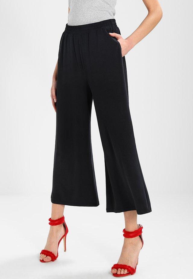 MOULAN - Pantaloni - black