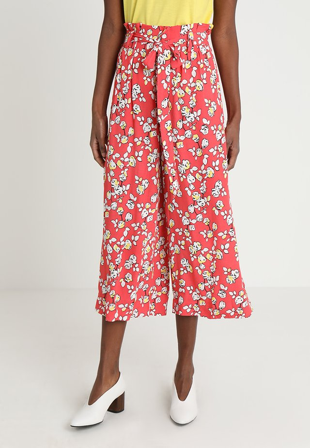 ANNELOT - Trousers - red/white