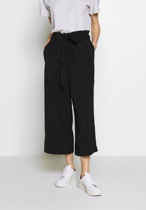 DEONNA - Trousers - black
