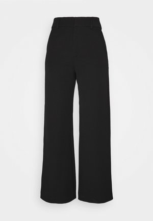 GENNIE - Pantalones - black